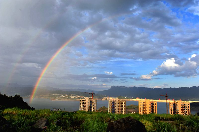 Photo taken on Aug. 4, 2015 shows double rainbows appearing at the Three Gorges Reservoir in Maoping township, Zigui county, central China's Hubei Province. ...