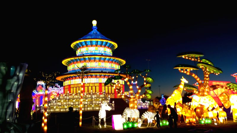 Photo taken on Dec. 3, 2015 shows an illumination modelling the Temple of Heaven at the Magic Winter Lights Show in Houston, the United States. The Magic Winter ...