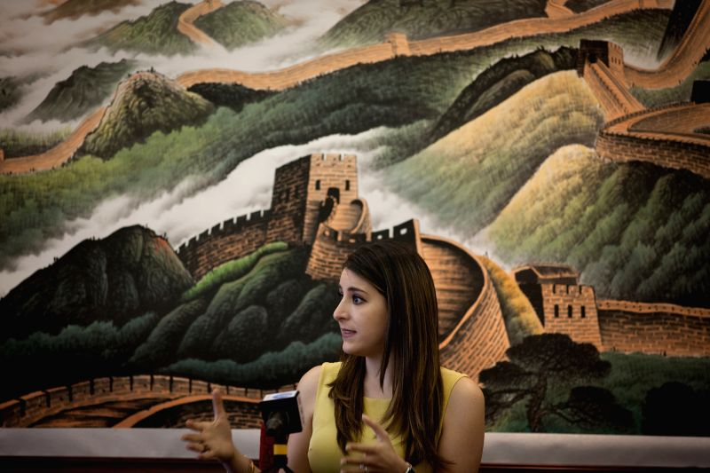 Photo taken on Dec. 3, 2015 shows the secretary of Mexico's ruling Institutional Revolutionary Party (PRI) Lila Abed Ruiz, receiving an interview with Xinhua in ...