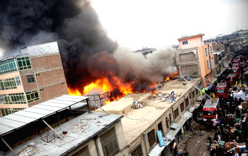 Photo taken on Dec. 5, 2015 shows smoke rising from a market in Kabul, Afghanistan. Several shops turned to ashes as a massive fire engulfed a market in a main ...