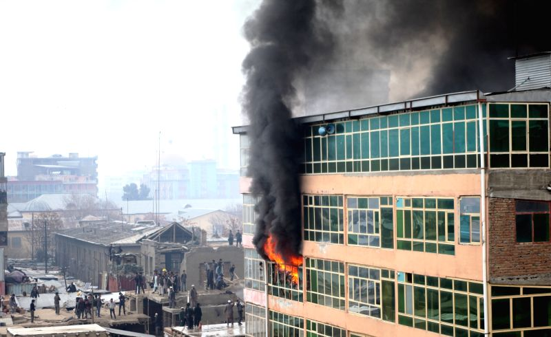 Photo taken on Dec. 5, 2015 shows smoke rising from a building at a market in Kabul, Afghanistan. Several shops turned to ashes as a massive fire engulfed a market in ...