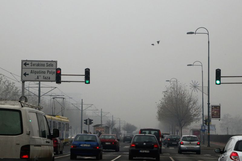 Photo taken on Dec. 8, 2015 shows a view  on the street in Sarajevo, Bosnia-Herzegovina, on Dec. 8, 2015. Sarajevo experienced air pollution on Tuesday. ...