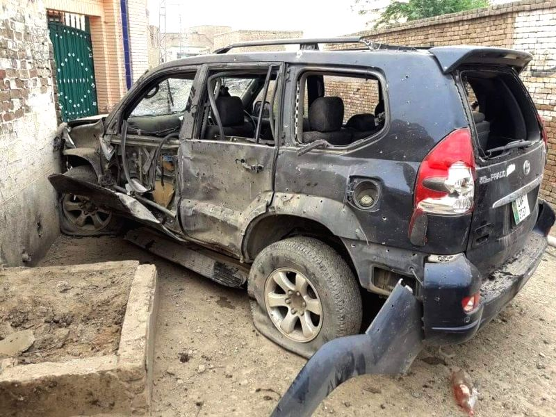 Photo taken on July 22, 2018 shows a damaged vehicle at the blast site in northwest Pakistan's Dera Ismail Khan. At least five people including a local ... - Dera Ismail Khan