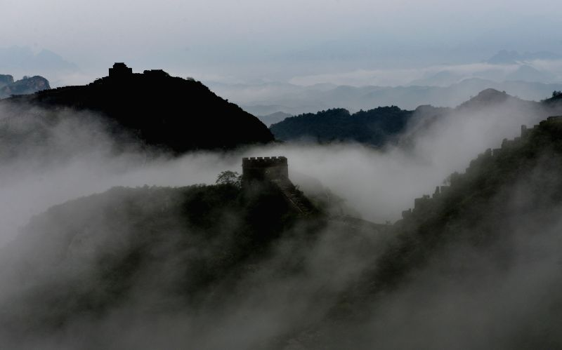 Photo taken on July 28, 2015 shows the Jinshanling Great Wall after a rainfall in Luanping County, north China's Hebei Province. (Xinhua/Guo Zhongxing)