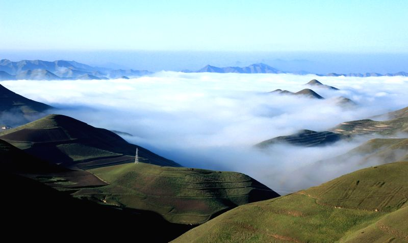 Photo taken on June 30, 2015 shows the cloud scenery in Bianling Village of Tongyuan Township in Yongdeng County, northwest China's Gansu Province. (Xinhua/Lin ...