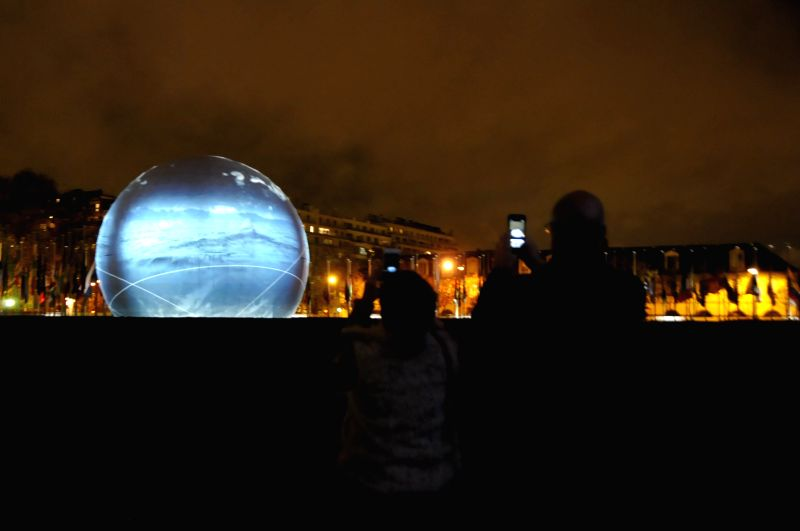 Photo taken on Nov. 16, 2015 shows a projection of pictures and videos on a building of the United Nations Educational, Scientific and Cultural Organization (UNESCO) ...