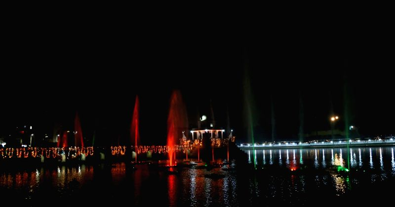 Photo taken on Nov. 16, 2015 shows colourful water fountains decorating Rani Pokhari Pond for Chhath festival in Kathmandu, Nepal. Chhath festival is an ancient ...