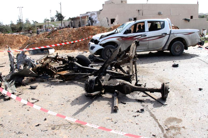 Photo taken on Nov. 24, 2015 shows a car wreckage at the site of a bomb attack in Msallata, Libya. A car bomb hit the town of Msallata in western Libya on Tuesday, ...