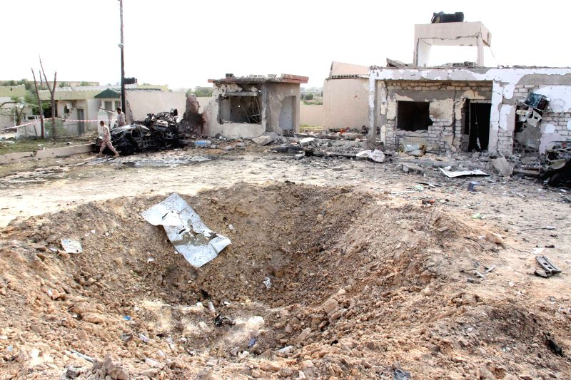Photo taken on Nov. 24, 2015 shows a crater at the site of a bomb attack in Msallata, Libya. A car bomb hit the town of Msallata in western Libya on Tuesday, ...