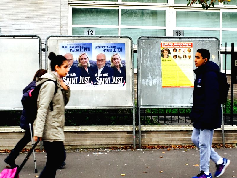 Photo taken on Nov. 26, 2015, shows posters of candidates running for the upcoming regional December 6-13 elections in the Paris region, France. (Xinhua/Zheng ...