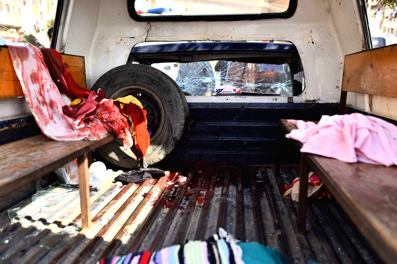 Photo taken on Nov. 28, 2015 shows blooded clothes on a police car on the site of an attack in Giza, Egypt. Unknown militants shot four policemen dead Saturday on the ...