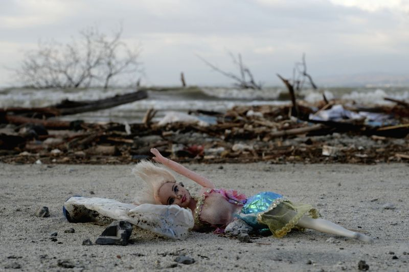 :Photo taken on Oct. 10, 2018 shows an abandoned doll in Palu, Central Sulawesi, Indonesia. The Indonesian national disaster agency put the death toll from multiple ...(Image Source: IANS)