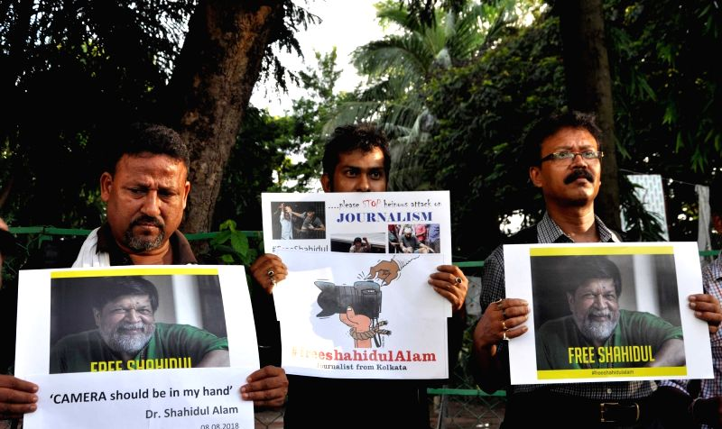 Photojournalists stage a demonstration against the detention of eminent Bangladeshi photographer and educator Shahidul Alam in Dhaka under the provisions of the Information and Communication ...