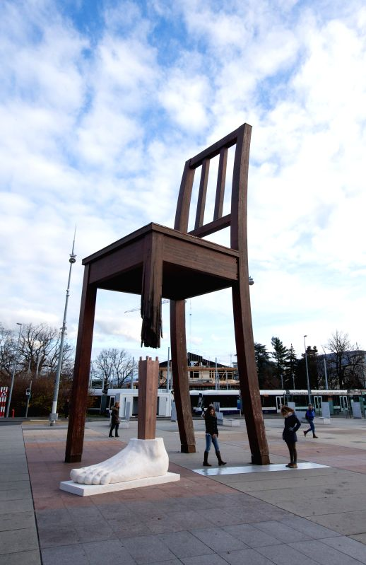 "Photos taken on Nov. 30, 2015 shows the famous sculpture ""Broken Chair"" installed with a ""new leg"" and a ""new foot"" on Place des ..."