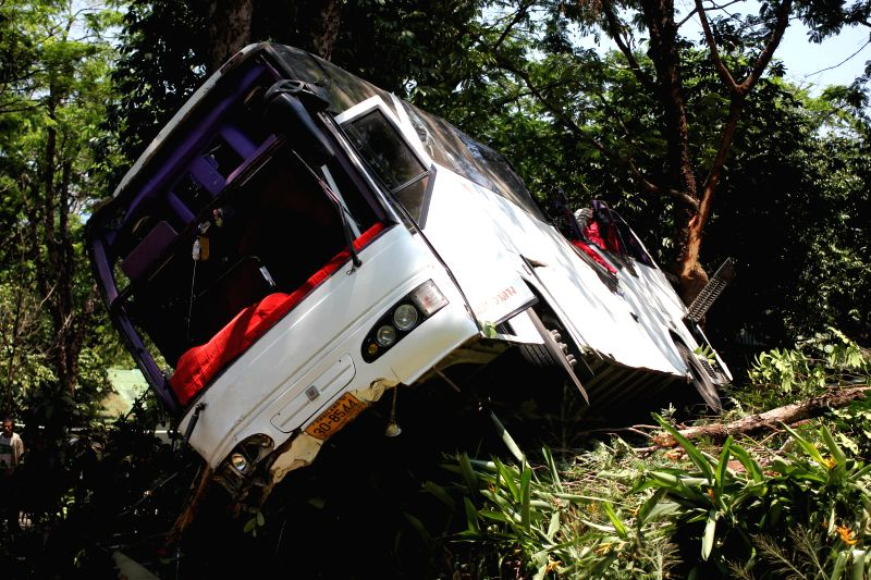 Photo taken on March 25, 2015 shows the damaged bus at the accident site in Phuket Island, Thailand. Three Chinese tourists, two females and one male, were ...