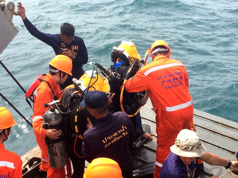 PHUKET, July 13, 2018 - Members of Thai and Chinese rescue team search for the body trapped by the wreckage of the sunken tourist boat Phoenix in Phuket, Thailand, July 13, 2018.