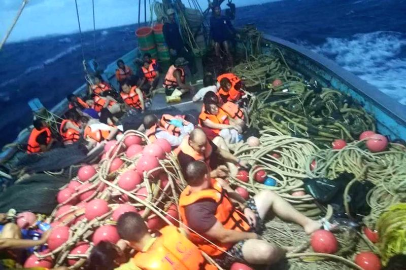 PHUKET, July 6, 2018 - Rescued tourists are seen on a boat near the island of Phuket, Thailand, July 5, 2018. Until 8:30 p.m. local time (1330 GMT) Thursday, the majority of 133 passengers on two ...