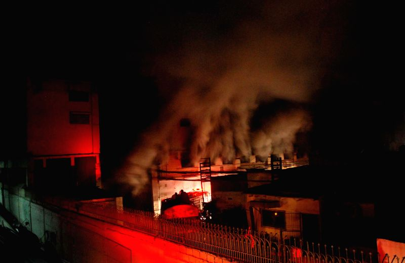 Picture taken on Dec. 5, 2014 shows a scene of the site of fire accident in southern Pakistani port city of Karachi. A textile factory in Karachi caught fire on Friday night.