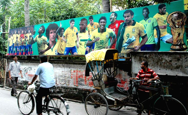 Pictures of Brazilian soccer players along a road ahead of their Round of 16 match against Chile during the FIFA World Cup 2014 in Kolkata on June 28, 2014.