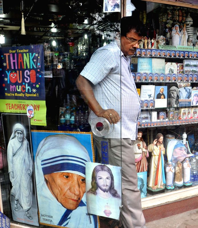 Pictures of Mother Teresa displayed in a Kolkata shop on the eve of the death anniversary of Mother Teresa on Sept 4, 2014.