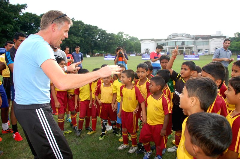 Piet Hubers, UEFA grassroots expert interacts with the participating children during the Hero Indian Super League Club's Grassroots Program Workshop at Bidhannagar Municipal Sports Complex in Kolkata
