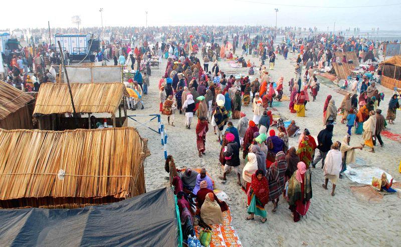 Pilgrims gather at Gangasagar island for a holy dip a day ahead of Makar Sankranti some 160 kms south of Kolkata on Jan 13, 2015.