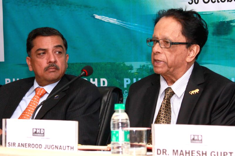 Pime Minister of Mauritius Anerood Jugnauth, addresses regarding business opportunities in Mauritius at PHD House in New Delhi, on Oct 30, 2015. Also seen PHD Chamber President Alok B ...