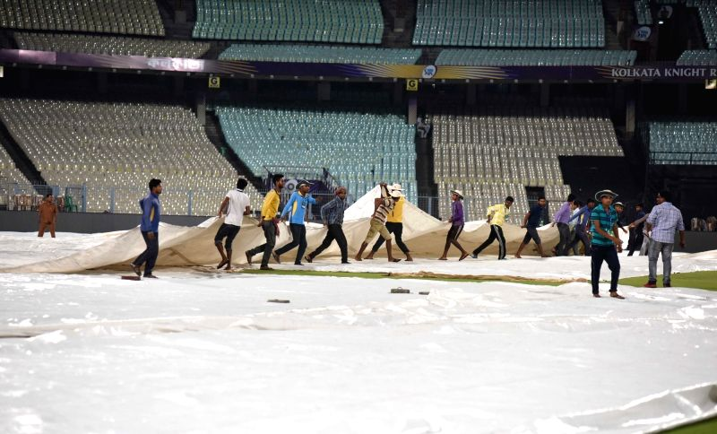 Plastic sheets being removed from the ground ahead of Kolkata Knight Riders' practice session, in Kolkata on April 12, 2018.