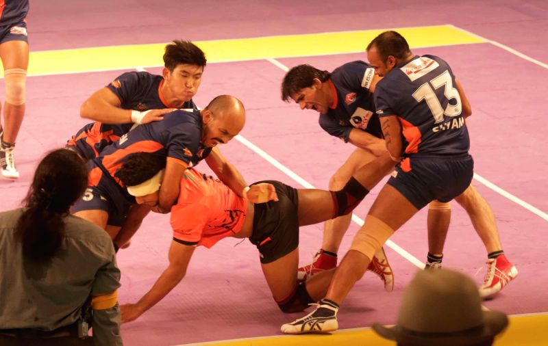 Player in action during a Kabbadi match between Bengal Warriors and Mumbai at Netaji Indoor Stadium in Kolkata Aug. 2, 2014.