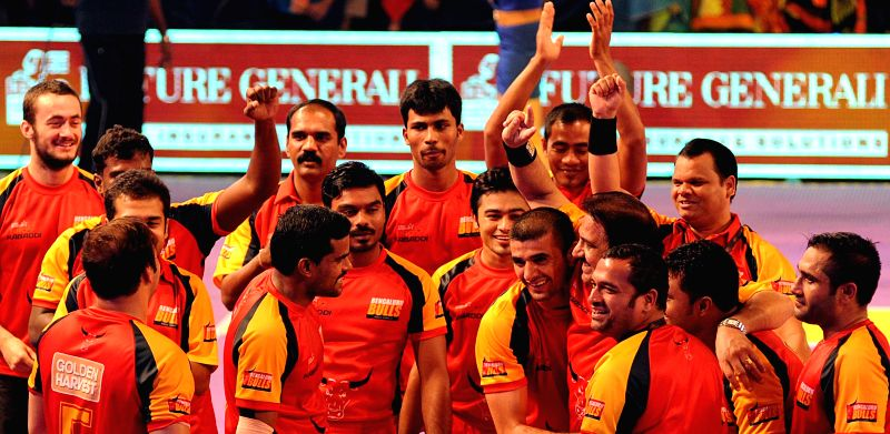 Players Bengaluru Bulls - kabbadi team celebrate after winning a Pro Kabaddi League match against Bengal Warriors at Netaji Indoor Stadium in Kolkata on July 30, 2014. Bengaluru Bulls  won the match.