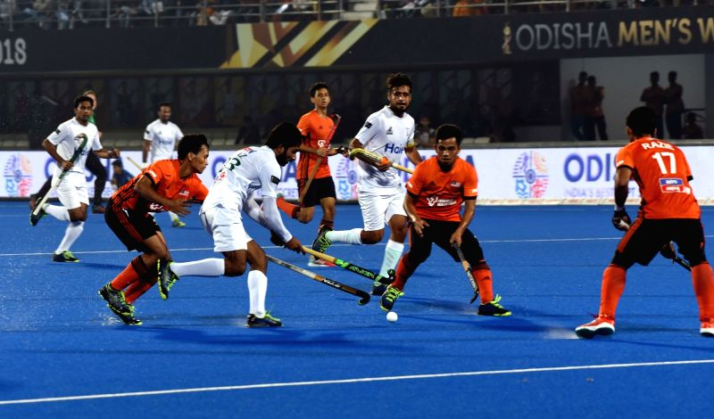 Players in action during a Men's Hockey World Cup 2018 between Pakistan and Malaysia at Kalinga Stadium in Bhubaneswar on Dec 5, 2018.(Image Source: IANS)