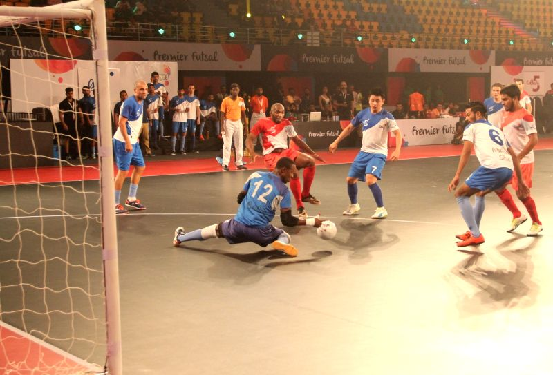 Players in action during a Premier Futsal match between Goa and Kolkata at Duler Stadium in Mapusa, Goa on July 19, 2016.