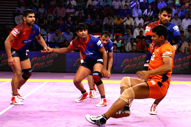 Players in action during a Pro Kabaddi League match between Bengal Warriors and Dabang Delhi in New Delhi on Aug 6, 2014.