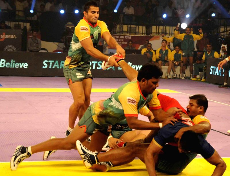 Players in action during a Pro Kabaddi League match between Patna Pirates and Puneri Paltan at Patliputra Indoor Stadium in Patna on Aug 7, 2014. Patna Pirates won. (Score: 35 - 27).
