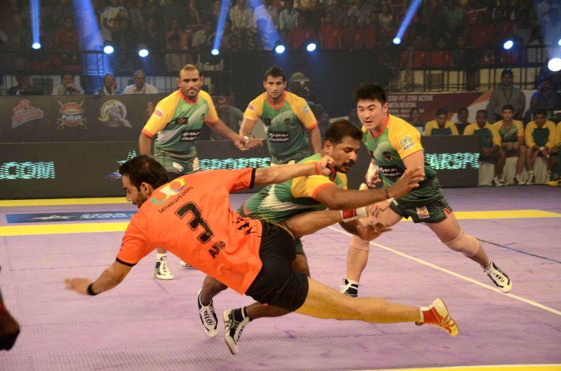 Players in action during a Pro Kabaddi League match between Patna Pirates and U Mumba at Patliputra Indoor Stadium in Patna on Aug 8, 2014.