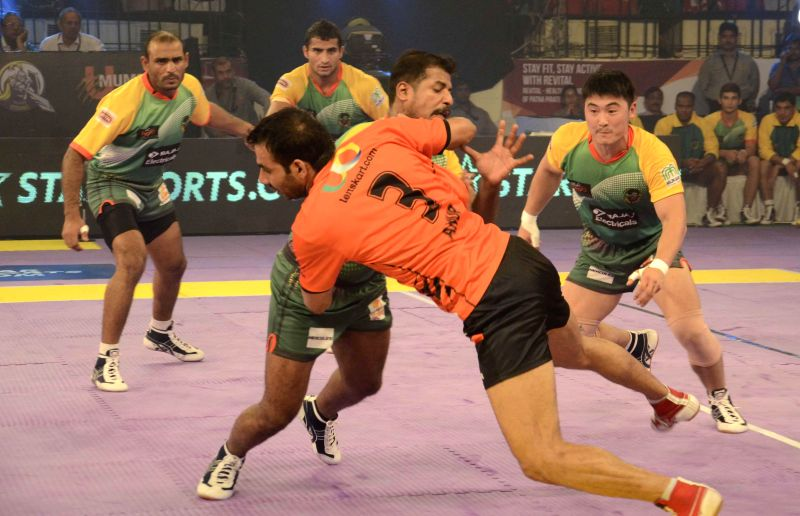 Players in action during a Pro Kabaddi League match between Patna Pirates and U Mumba at Patliputra Indoor Stadium in Patna on Aug 8, 2014.