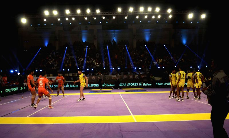 Players in action during a Pro Kabaddi League match between Bengal Warriors and Telugu Titans at Patliputra Indoor Stadium in Patna on Aug 8, 2014. Bengal Warriors won. (Score: 40 - 35).
