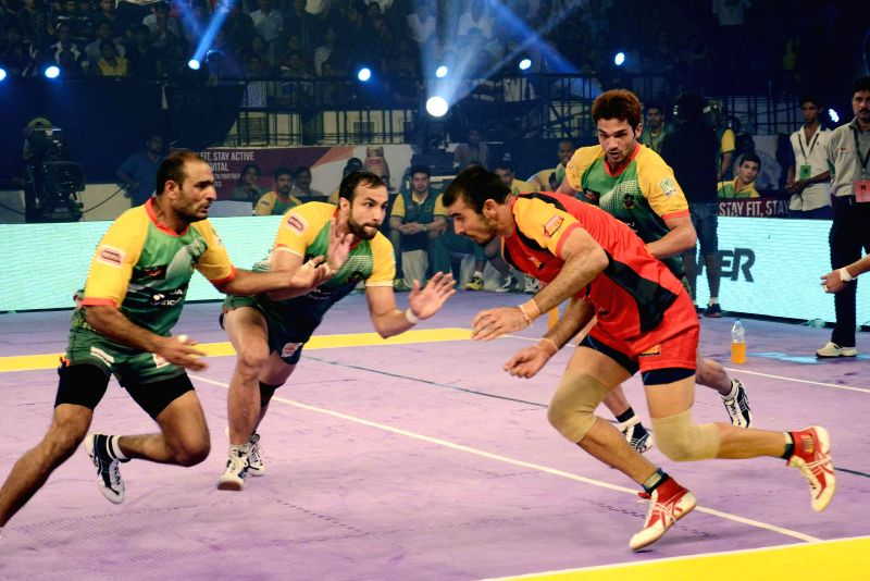 Players in action during a Pro Kabaddi League match between Patna Pirates and Bengaluru Bulls at Patliputra Indoor Stadium in Patna on Aug 10, 2014. Bengaluru Bulls won. Score: 37 - 35.