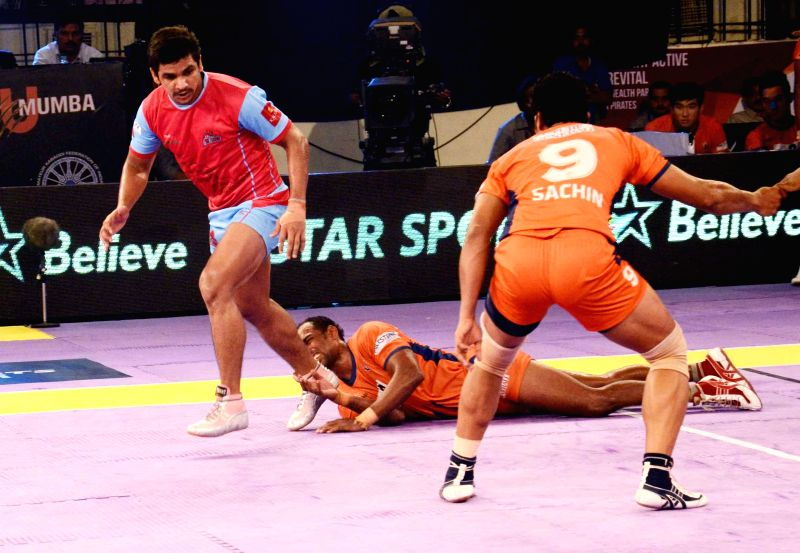 Players in action during a Pro Kabaddi League match between Jaipur Pink Panthers and Bengal Warriors at Patliputra Indoor Stadium in Patna on Aug 10, 2014. Jaipur Pink Panthers won. Score: 39 - 23.