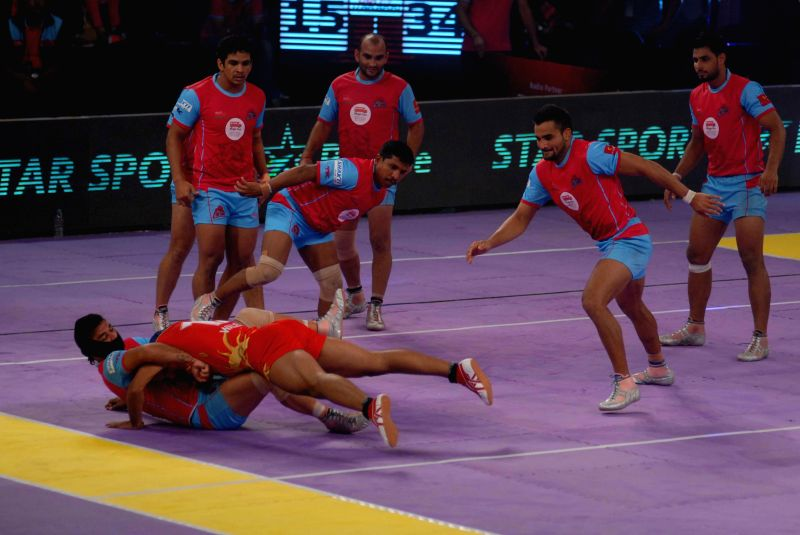 Players in action during a Pro Kabaddi League match between Jaipur Pink Panthers and Puneri Paltan at Boxing Arena Balewadi Stadium in Pune on Aug 14, 2014. Jaipur Pink Panthers won. Score: 50 - 23.
