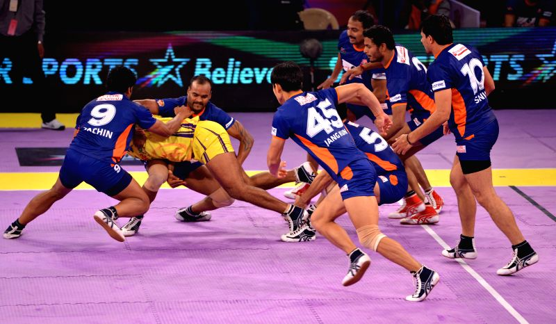 Players in action during a Pro-Kabaddi League match between Bengal Warriors and Telugu Titans at Sawai Mansingh Stadium in Jaipur on Aug 22, 2014.