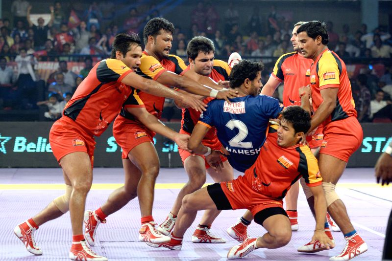 Players in action during a Pro-Kabaddi League match between Bengal Warriors and Bangalore Bulls at Kanteerava Indoor Stadium in Bangalore on Aug 24, 2014.