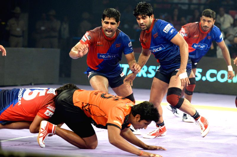 Players in action during a Pro-Kabaddi League match between U Mumba and Dabang Delhi at Kanteerava Indoor Stadium in Bangalore on Aug 24, 2014.U Mumba won. Score: 37 - 30.