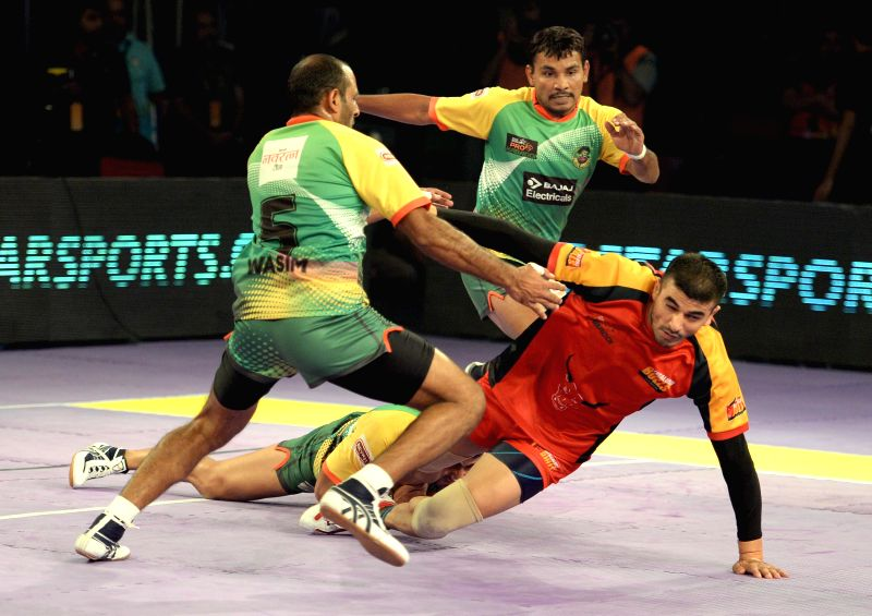 Players in action during a Pro-Kabaddi League match between Patna Pirates and Bengaluru Bulls at Kanteerava Indoor Stadium in Bangalore on Aug 25, 2014.Dabang Delhi won. Score: 33 - 31.