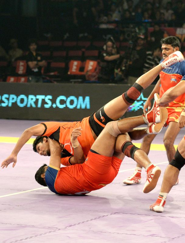 Players in action during a Pro-Kabaddi League match between Puneri Paltan and U Mumba at Kanteerava Indoor Stadium in Bangalore on Aug 26, 2014.U Mumba won. Score: 36 - 35.