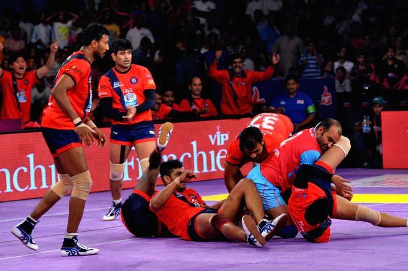 Players in action during a Pro Kabaddi league match between Dabang Delhi and Jaipur Pink Panthers at Sawai Mansingh Stadium in Jaipur, on July 29, 2015.