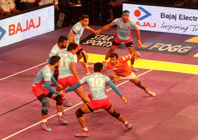 Players in action during a Pro Kabaddi League 2016 match between Puneri Paltan and Jaipur Pink Panthers in Kolkata, on July 17, 2016.