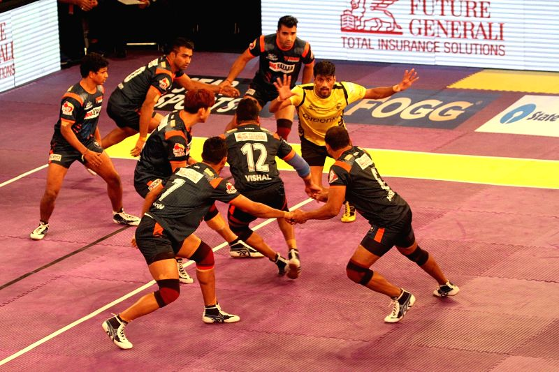 Players in action during a Pro Kabaddi League 2016 match between Bengal Warriors and Telegu Titans in Kolkata, on July 18, 2016.