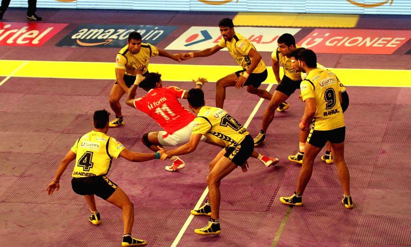 Players in action during a Pro Kabaddi League 2016 match between Telugu Titans and Dabang Delhi in Kolkata, on July 19, 2016.
