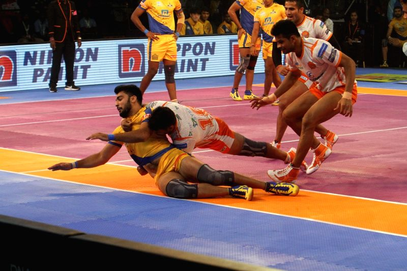 Players in action during a Pro Kabaddi League 2017 match between Puneri Paltan and Tamil Thalaivas in Chennai, on Sept 29, 2017.